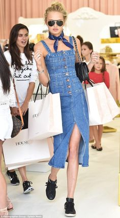 Stylish in denim! Romee, 20, looked trendy in a curve-hugging jean dress and carried a Chanel bag along with multiple shopping bags