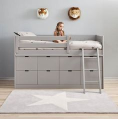 kids bed with lots of storage. I kind of like this type of bunk bed where underneath is the whole dresser. Then having two in the room for my boys versus a regular bunk bed. Seems a little shorter too which I like.