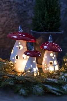 Cute toadstool tea-light holders with Tomte on top. Drömhuset.