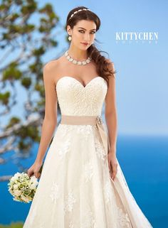 This is a Kitty Chen dress that we will be receiving for our Kitty Chen trunk show. This means this (and other Kitty Chen dresses) will be in our store to order from May 6th-8th ONLY! Mark your calendars! And follow our Pinterest @mycouturebridal to see all the dresses we will be receiving! and like OMG! get some yourself some pawtastic adorable cat shirts, cat socks, and other cat apparel by tapping the pin!