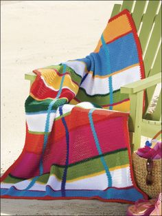 "Vertical lines of color cross easy horizontal stripes to form this color-rich plaid. This e-pattern was originally published in the June 2010 issue of Crochet World magazine. Size: 37"" x 60"". Made with medium (worsted) weight yarn and size H (5mm) hook. Skill Level: Easy"