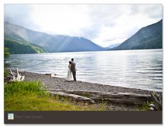 Water and mountains always make for stunning wedding pictures! Love this bride and groom portrait!
