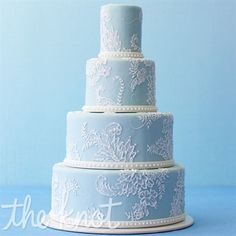 For an elegant cake, balance allover color with soft accents, like painted white sugar flowers and crimped white-fondant bands. Cake by Jan Kish la petite fleur