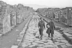 New Zealand soldiers passing through the ruins of Pompeii, Italy, 1944.