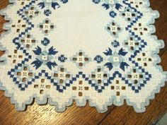 An ab fab dresser scarf or table runner that features lavish Hardanger embroidery on snowy white cotton fabric. The embroidery is in two shades of blu