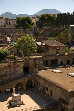 Herculaneum and Vesuvius in the background, the entire town was preserved under molten ash when the volcano erupted in roman times they are still finding new stuff