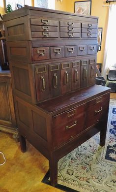 Antique Globe File Cabinet - love, love, LOVE this legal/pharmacy style filing case. #drawerlove