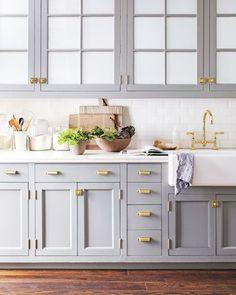 Gray kitchen with brass hardware