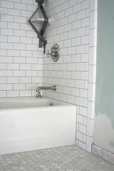 Good example of white subway tiles with preferred grey grout for our kitchen splashback. the grout color makes it hex floor with white subway wall. like the grey grout Upstairs Bathrooms, Bathroom Floor Tiles, Downstairs Bathroom, Bathroom Renos, Room Tiles, White Bathrooms, Bathroom Ideas, Family Bathroom, Tile Floor