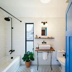 We want a black shower. Love the flash of blue in the door to break up the monochrome. And top tip for this colour scheme: plants! (via Houzz)  For more interiors inspiration go to the ACHICA blog www.achicaliving.com