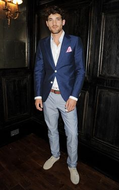 blue suit with pop of pink