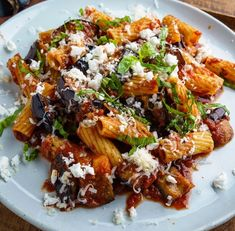 Pasta Alla Norma - A quick and easy eggplant pasta topped with fresh basil and plenty of cheese! Eggplant Recipes Pasta, Easy Pasta Recipes, Roasted Eggplant Pasta, Pasta With Eggplant Sauce, Pasta With Aubergine, Eggplant Dishes, Italian Dishes, Italian Recipes, Italian Foods