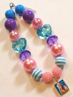Love this gal's jewelry for little girls who like sparkle. Super cute!  Tangled Rapunzel Disney's Girls Chunky by HauteTottiesBling, $23.00