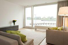 Light living room, soft colors. (Westerdoksdijk 1013 AD Amsterdam | Expat Housing)