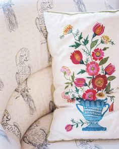 January February 2013 Issue Photo - An embroidered pillow placed on an upholstered chair