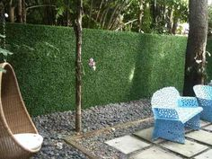 Artificial boxwood privacy hedge