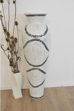 A large quality terracotta vase which has been hand finished in white and silver mosaic triangular pieces to give this impressive piece of furniture. Standing at a height of 3ft9 (120cm) this vase is an ideal addition to any room in need of the extra special finish. Manufactured to the highest standard and delivered to your door using our specially selected carrier which specialise in delivering fragile items. Free Returns across the range.