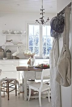 French infspired white kitchen...can someone get that cat off the table???