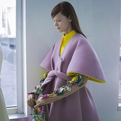 A kimono wrap coat with petal sleeves, lined in goldenrod yellow, is accented by botanic-embellished leather gauntlets at #Delpozo's #FW16 runway.  Shop @officialdelpozo at #NETAPORTER #FashionWeek #NYFW  Lensed by @nowfashion