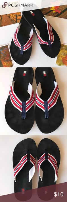 Tommy Hilfiger: Flip Flops Tommy Hilfiger: red, white and blue strap and the sole is black. Size 6. I took the sticker off with the size when I bought them, so no size on shoe. In my opinion they are a little smaller then a 6. My heel goes right to the edge. Condition: good, they have been worn. Flaws: toe imprints, heel has some marks due to size sticker being there. Inside of strap are some dirt marks and part of the flag worn off on right (refer to pictures). Reasonable offers welcomed…