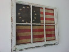 The old American flag canvas is mounted behind a vintage six pane window on Etsy, $120.00