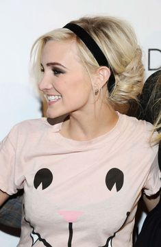Fancy up a messy bun in seconds by adding a simple, black stretchy headband, like Ashlee Simpson did.
