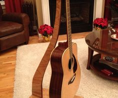 """I created this guitar stand as a """"under $10"""" secret santa gift using some leftover plywood and stain. Most of the actual cost went into the hardware."""