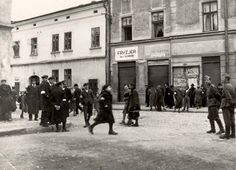 Nowy Sacz, Poland, 1940, Jews and German soldiers on a street in the ghetto.