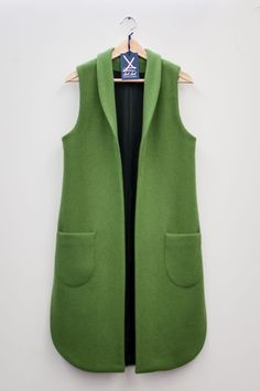 "This long vest brings the ""spring"" in autumn. It goes well with neutral staples and gives a subtle pop of color to a fall ensemble."