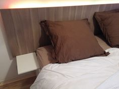 I wanted a new look for my IKEA Brimnes bed. I added a headboard, LED lights and side tables to it.