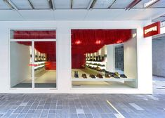30,000 shoelaces hang from Melbourne Camper store ceiling http://www.dezeen.com/2015/03/02/melbourne-camper-store-marko-brajovic-30000-red-shoelaces-ceiling/