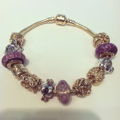 All gold bracelet with all gold charms from pandora, 6628$