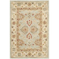 Add a pop of pattern to your living room or den with this hand-tufted wool rug, showcasing a Persian-inspired motif in blue and beige.