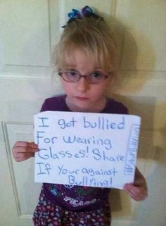 My parents bullied me into holding this sign. 'Like' if you want to bully bullies into not bullying.