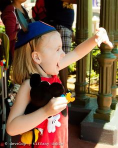 {How to photograph your vacation} Tip 3: Capture their reactions. Which would you rather remember, how Mickey Mouse looked on that fine sunny day or what your child thought of him?