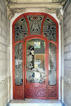 """Barcelona - Diputació 227 e"" by Arnim Schulz on Flickr - Aussiegirl.  Stained Glass Art Nouveau Door located in Barcelona, Catalonia, Spain"