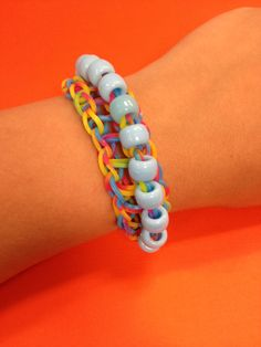 A tie dye Bandaloom bracelet with blue beads. #bands #loom #diyjewelry
