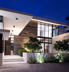 Designed for a family of six by KZ Architecture, this modern two-storey private residence is situated in Golden Beach, Florida.