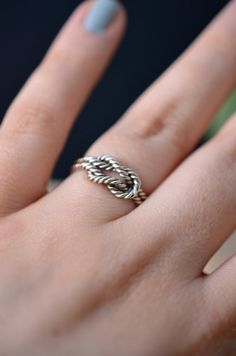 Remember me, sailor - nautical rope ring.  I think this one would make a pretty nice engagement ring! The rope is made from a bunch of twisted sterling silver wire, solder together in the shape of a lovely knot. Handmade in sterling silver. Nickel free!  MADE TO ORDER & shipped in 3 to 5 business days, with a tracking number for residents of Canada and the U.S. only. Tracking numbers arent available for other countries. Measurements: Knot: 12 mm long X 8 mm wide  Got questions about my wo...