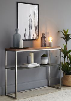 Walnut, Black Chrome and Grey Frosted Glass Console Table. Sleek metal frame, solid and sturdy and perfect for any room in your home.