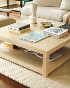 Raffia cocktail table. Adds a great texture to the room.  I prefer the square style and love the you can put books and such underneath.  From Serena and Lilly.