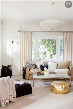 Gold accents add a bit of luxe to an elegant living area (a gold moroccan pouf is the accent in this living area...)