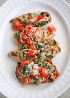 Grilled Bruschetta Chicken by thegirlwhoateeverything: Here's one of our healthy meal staples that we cook all the time. It's full of flavor, only 200 calories, and has only five ingredients. It has all the flavors of bruschetta but without the bread…or the carbs. #Chicken #Bruschetta #Healthy #Light