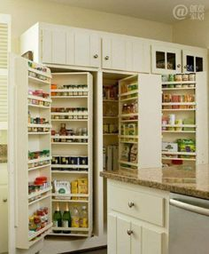 Built-In Pantry Shelving--Tall cabinet doors open to reveal multiple layers of shelving units in this well-stocked built-in pantry. Description from pinterest.com. I searched for this on bing.com/images
