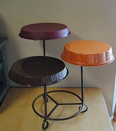 DIY pie/cake stand. Paint dollar store pans and attach them to an old plant stand.