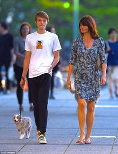 Casual style: Model Helena Christensen and son Mingus Reedus took their new puppy Kuma for a walk in New York City on Tuesday