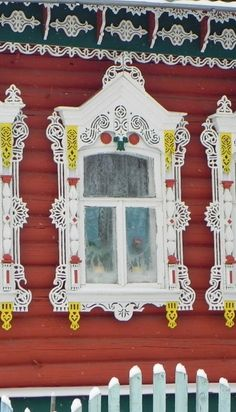 Russian wooden house. A window with  openwork carved decorations. #Russian #wooden #house