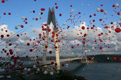 Red and white balloons, symbolizing the colors of the Turkish flag, float during the inauguration of the Yavuz Sultan Selim Bridge in Istanbul on Aug. Bosphorus Bridge, Bridge Card, White Balloons, The Washington Post, Yolo, Rafting, Red And White, Fair Grounds, Christmas Tree