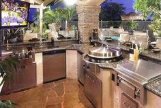 Contemporary Patio with Granite counters, Flagstone patio, Outdoor kitchen