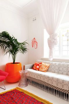 13 Chic & Modern Ways to Decorate with Color | Bright orange rug and plant pot | @stylecaster